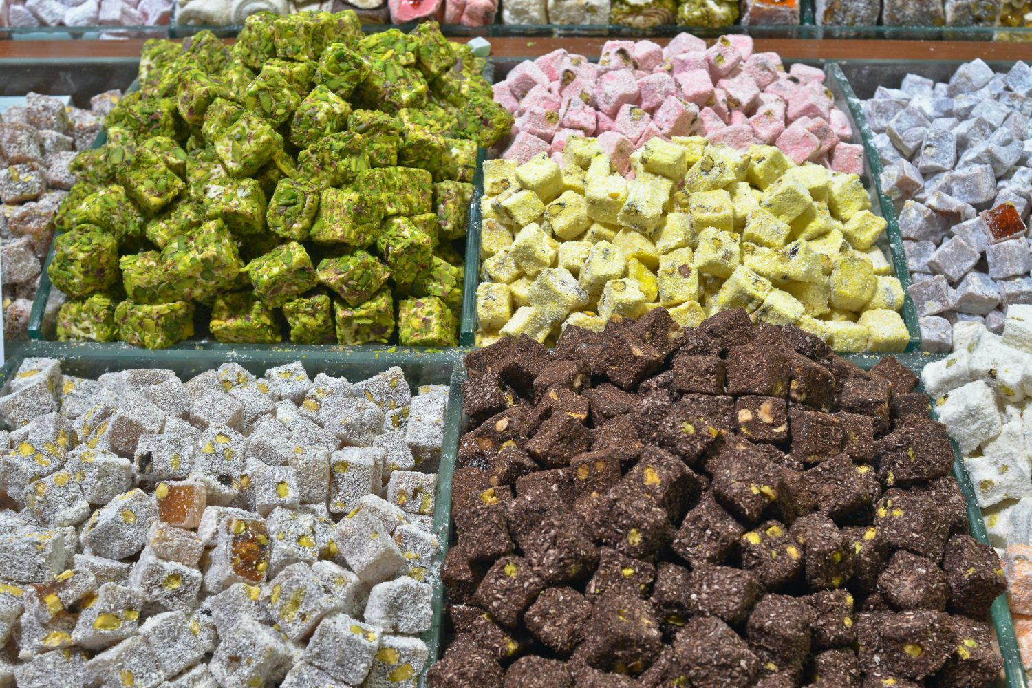 assorted color of stones on green plastic crate